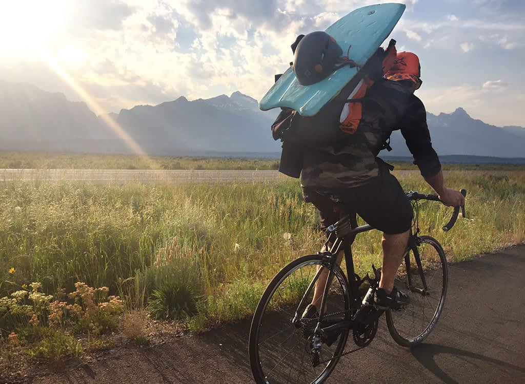 """Tristan Greszko cruises along the pathway in GTNP en route to a swim across Phelps Lake and a climb of Mt. Albright, Static Peak, and Buck Mountain—and back again—in a Picnic dubbed the """"Triple Buck."""""""