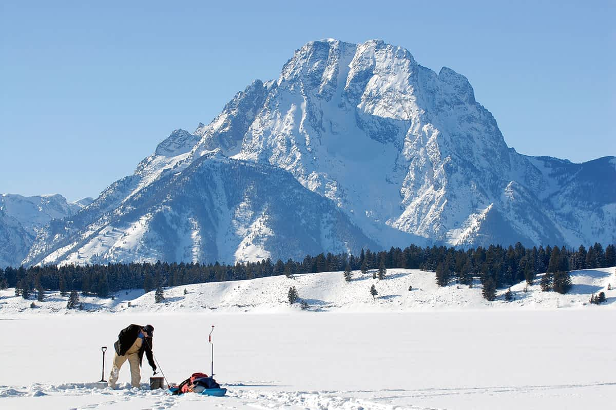 Ice fishing on Jackson Lake can be a chilly affair, but the view is unparalleled.