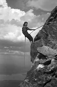 Margaret Smith Craighead, one of the party of four women to do the first manless ascent of the Grand Teton (in 1939), is shown here rappelling.