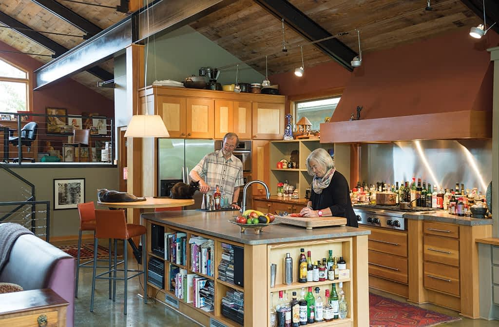 Architect Larry Berlin lives with partner Pam Case in one of three sister houses he designed in East Jackson. The home's exterior features clean lines and warm materials. Inside it's comfortable and eclectic.