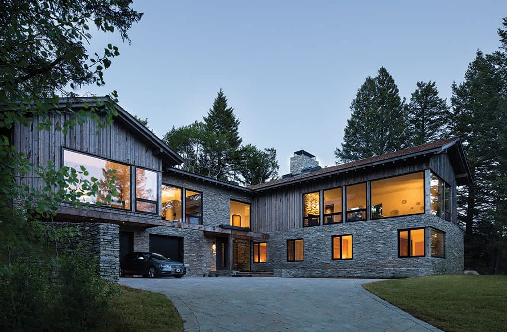 The 8,500-square-foot home nestled into a steep wooded lot had to meet the neighborhood's mostly traditional building codes. Dynia and project architect Karen Parent managed to do that while still allowing the home to be progressive. The exterior is a mix of Oakley stone and grey-patinaed, repurposed wind fencing from Montana.
