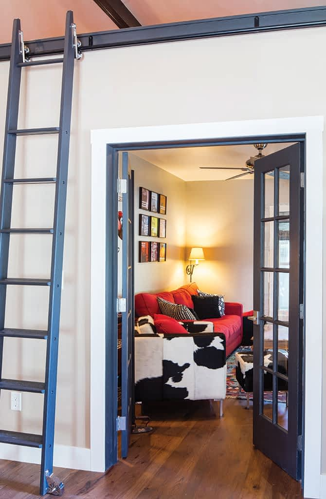 The couple turned one of the former bedrooms into a television room.