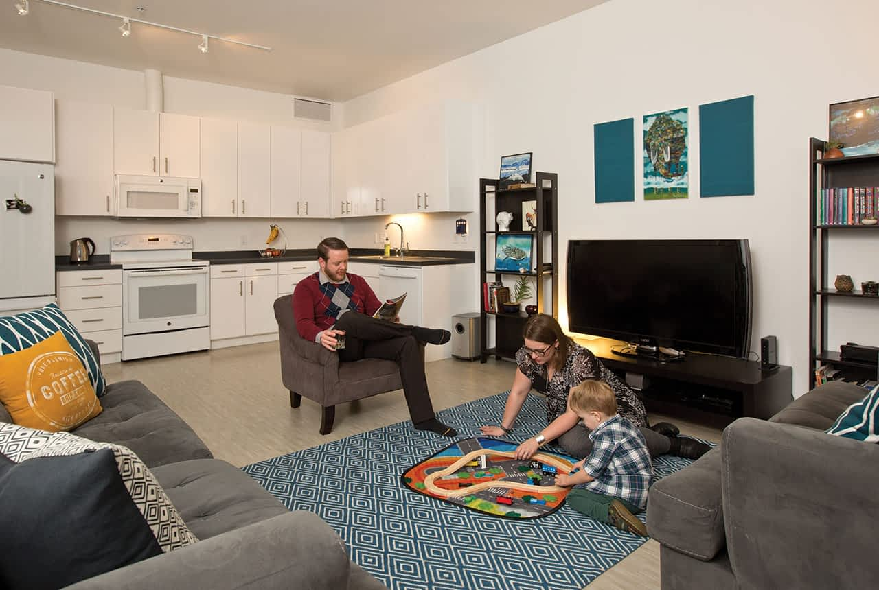 Jessica, Bryan, and Atticus in their main living space, which Jessica says feels modern, like the homes of her city-dwelling friends.