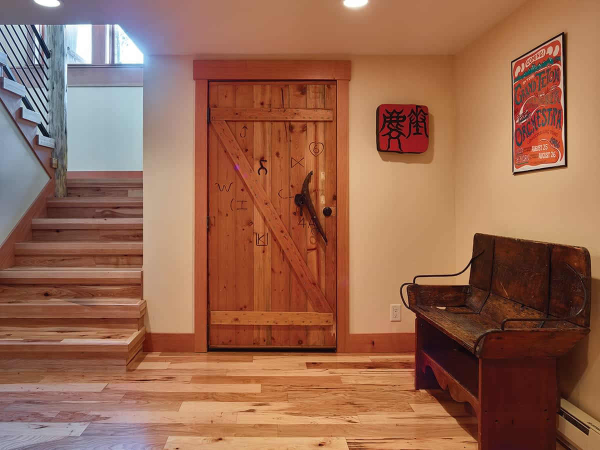 This field-built, Douglas fir door is the home's original front door. After the remodel, it was too short to meet Teton County's building code. The Wongs wanted to use it somewhere else in the house, though. The brands on it are from Jackson Hole ranches.