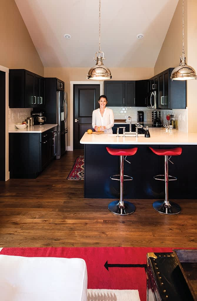 Frappart is shown in the kitchen, where Karman cabinetry is topped with Zodiaq snow white quartz. The chrome pendants are by Possini. Throughout the home, floors are Canadian hickory.