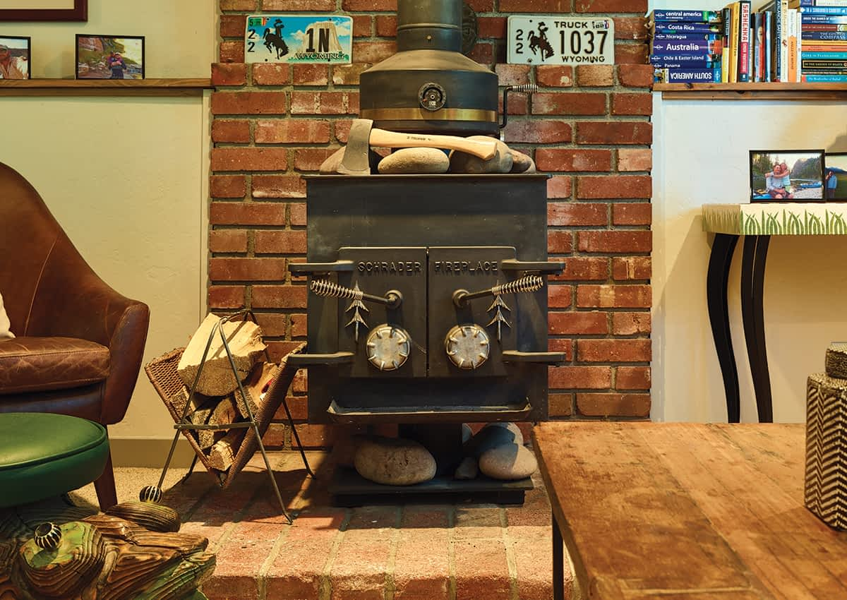 The downstairs wood-burning stove is original to the 1973-built home. Sally and Mike still use it to help heat the house in the winter.