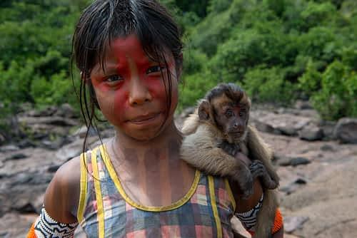 Kayapo girl with monkey