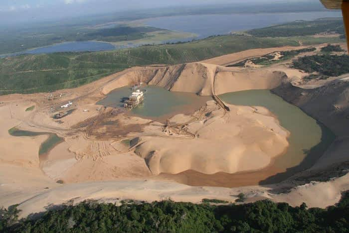 Photo: Paul Dutton. Sand dredge mining for titanium threatened Lake St. Lucia National Park (South Africa) and stimulated a public movement that re-created this area as the iSimangaliso Wetland park, a UNESCO World Heritage area.