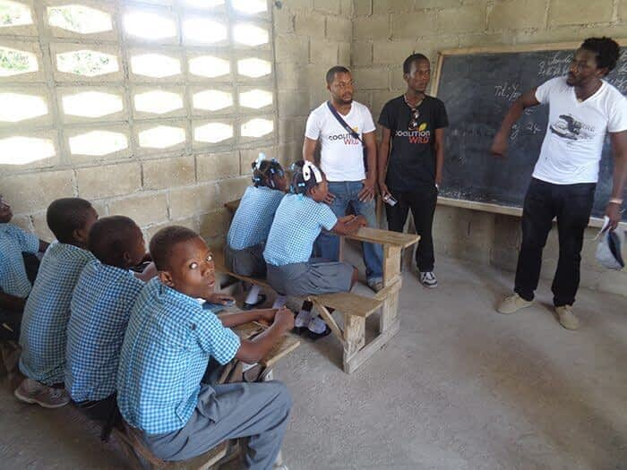 Augustin speaking about the CoalitionWILD Haiti Alliance to school children and the importance of community gardens.